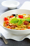 Spaghetti with bacon and dried chilli Stock Images