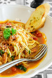 Spaghetti bacon tomato sauce Stock Photo