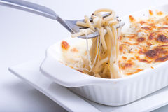 Spaghetti with baked cheese Royalty Free Stock Images