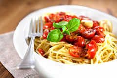 Spaghetti with baked tomatoes and garlic Stock Photos