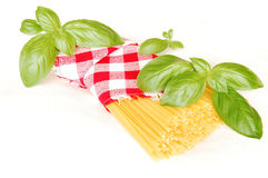 Spaghetti and basil. Covered by red and white checked napkin Stock Photography