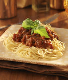 Spaghetti with basil garnish and tomato sauce. Stock Photo