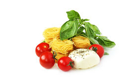 Spaghetti, basil,mozzarella and tomatoes Royalty Free Stock Photography