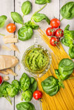 Spaghetti and basil pesto, ingredients for cooking Stock Photo