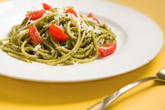 Spaghetti with basil pesto and tomatoes Royalty Free Stock Photo