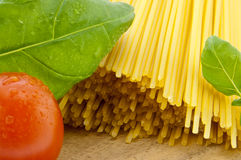 Spaghetti with basil and tomato Stock Photography
