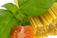 Spaghetti with basil and tomato - macro view Stock Image