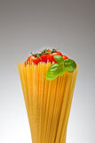 Spaghetti,Basil, Tomatoes. Close up of basic ingredients for italian pasta Stock Image