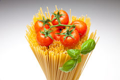Spaghetti,Basil, Tomatoes. Close up of basic ingredients for italian pasta Royalty Free Stock Photos