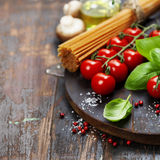 Spaghetti, basil and tomatoes Royalty Free Stock Images