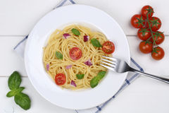 Spaghetti with basil and tomatoes noodles pasta meal from above Royalty Free Stock Image