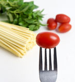 Spaghetti, basil and tomatoes. On white background Royalty Free Stock Photography
