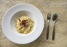 Spaghetti with becon on table Stock Photos