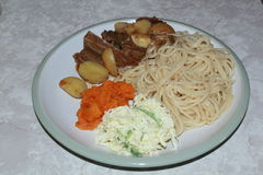 Spaghetti with beef stew. Butternut and coleslaw Royalty Free Stock Images