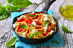 Spaghetti with bell pepper and brynza. Stock Photography