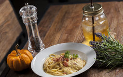 Spaghetti with beverage and garnish Stock Images