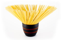 Spaghetti in black bowl Royalty Free Stock Images