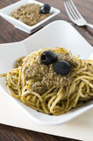 Spaghetti with black olive pesto. Stock Photos