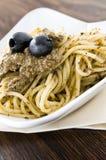 Spaghetti with black olive pesto. Royalty Free Stock Image