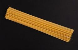 Spaghetti on Black Slate Base. Organic spaghetti on black slate base. Fine Italian food. Professional Studio Image Royalty Free Stock Photography