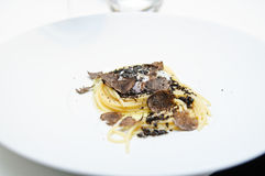 Spaghetti with black truffles. And fresh mascarpone stock photo