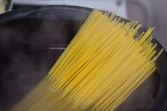 Spaghetti in boiling pot Royalty Free Stock Photography