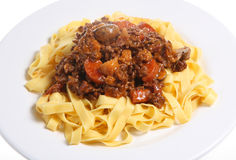 Spaghetti Bolognaise. Tagliatelle pasta with meat and tomato sauce. Visible steam rising Stock Photos