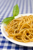 Spaghetti Bolognaise. A plate of Spagheti bolognaise garnished with leaves of basil Royalty Free Stock Photo