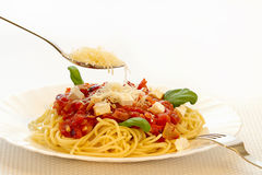 Spaghetti Bolognese. With Parmesan cheese on the spoon isolated Stock Photo
