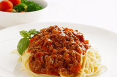Spaghetti Bolognese. And fresh salad Royalty Free Stock Images
