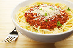 Spaghetti Bolognese. In a bowl with Parmesan cheese Royalty Free Stock Images
