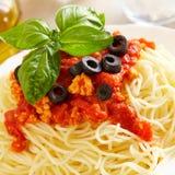 Spaghetti Bolognese. Original Italian spaghetti bolognese with basil and black olives Stock Photography