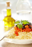 Spaghetti Bolognese. Original Italian spaghetti bolognese with basil and black olives with fork Stock Photography