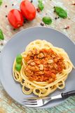Spaghetti bolognese with basil leave Stock Photos
