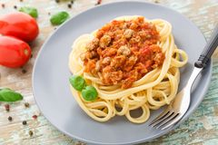 Spaghetti bolognese with basil leave Royalty Free Stock Photo