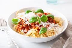 Spaghetti bolognese with basil and parmesan, italian pasta stock photo