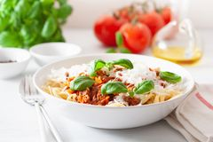 Spaghetti bolognese with basil and parmesan, italian pasta stock photography
