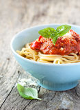 Spaghetti bolognese in blue bowl on vintage rustic wood Royalty Free Stock Photography