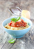 Spaghetti bolognese in blue bowl on vintage rustic wood Royalty Free Stock Photos