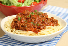 Spaghetti Bolognese or Bolognaise. Spaghetti bolognese with tomato salad Stock Photos