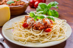 Spaghetti Bolognese. With cheese and basil Royalty Free Stock Image