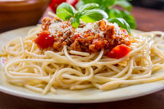 Spaghetti Bolognese with cheese and basil Royalty Free Stock Images