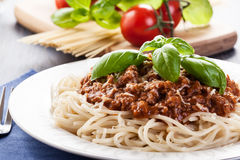 Spaghetti bolognese with cheese and basil Stock Photos