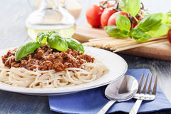 Spaghetti bolognese with cheese and basil Royalty Free Stock Photo