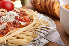 Spaghetti bolognese with cheese and a fork Stock Photo
