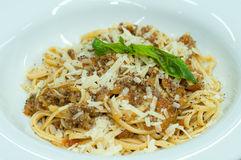 Spaghetti Bolognese. With cheese on a white plate Royalty Free Stock Image