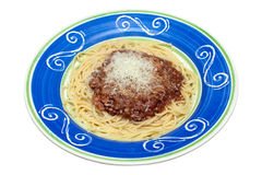 Spaghetti Bolognese. In a colourful hand painted dish on an isolated white background with a clipping path Royalty Free Stock Photography