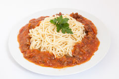 Spaghetti bolognese decorated with leaf on a white plate Stock Photo