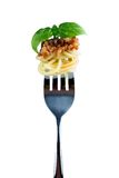 Spaghetti bolognese on fork with basil Stock Image
