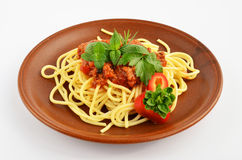 Spaghetti Bolognese 2. Spaghetti Bolognese with fresh herb spices - oregano, basil, rosemary, celery and red pepper, served on rustic, brown ceramic plate over Royalty Free Stock Photography